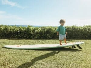 Henry on a surfboard things to do Maui