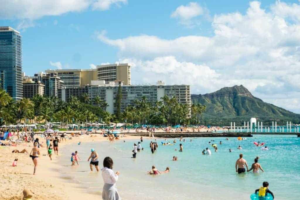 Waikiki busy beach crowd Hawaii